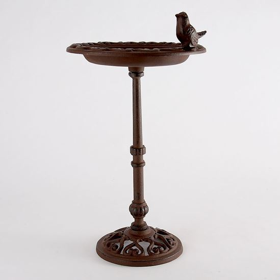 Cast iron bird bath on a pole