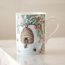 'Plant trees to help the bees' fine bone china mug designed by Amanda Loverseed