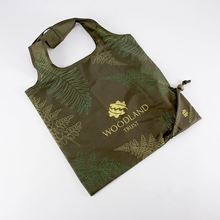 Woodland Trust dark green foldable shopper with a fern print design made from recycled plastic bottles