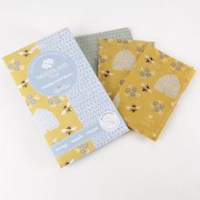 Woodland Trust family pack of beeswax wraps in beehive and bees designs